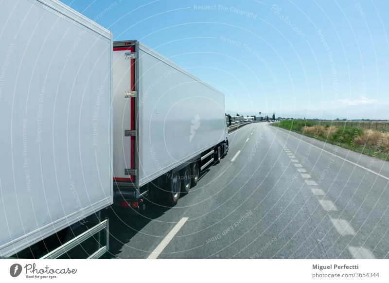 Mega-truck or Road train, special vehicle consisting of a truck and two trailers approved to transport 60 tons. mega truck road train refrigerated transport