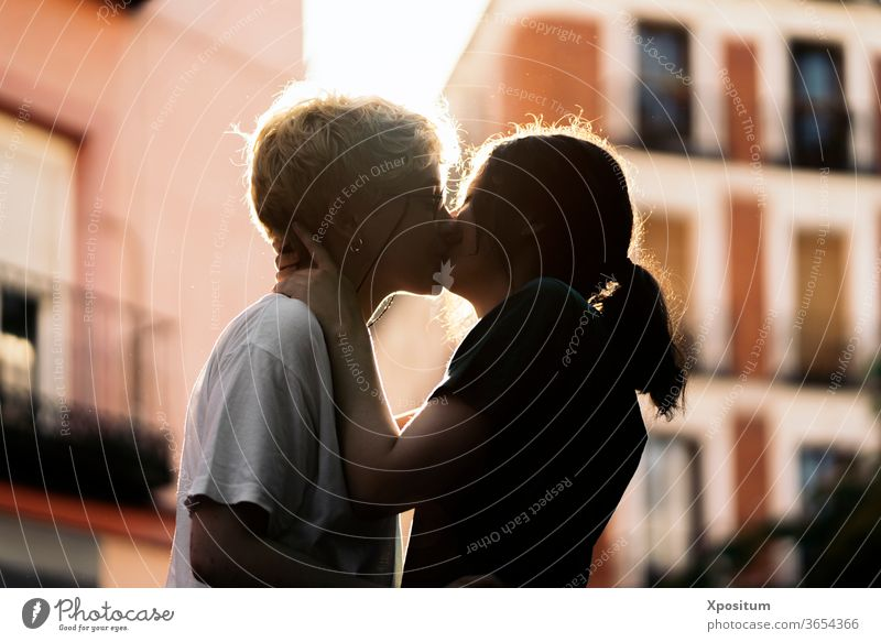 Young lesbian couple kissing date closeup close up unrecognizable young women together togetherness holiday sun diversity freedom joy romantic vacation