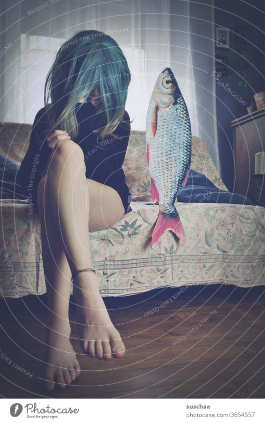 teenager with wig sitting on a sofa next to a fish date with fish foot Legs Film worthy Funny Looking youthful Idea History of the Wig Whimsical Puberty Strange
