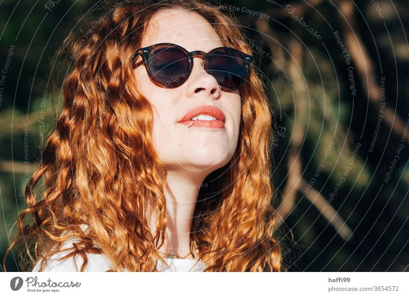 the young woman with sunglasses enjoys the sun Woman red lips Sunglasses pretty Youth (Young adults) curly hair natural red hair Curly Lifestyle Lovely