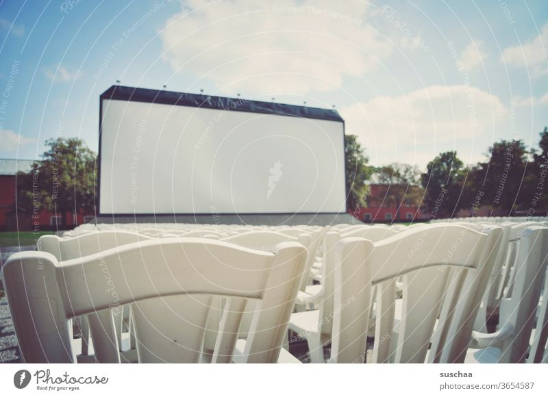 big outdoor cinema screen with chairs in front Introduction Seating capacity Seating arrangements spectators Empty viewless Open-air performance Open air cinema