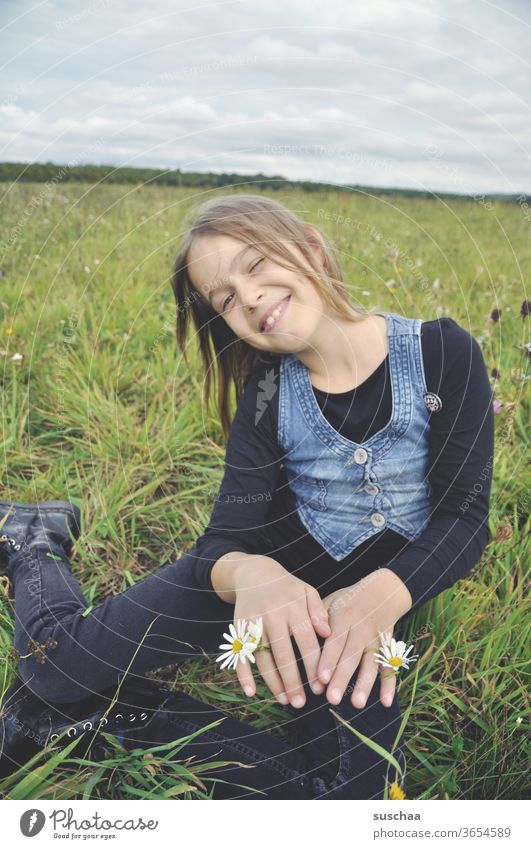 happy girl in the meadow with flowers on her hands Child Infancy Freedom fun Joy Nature meadow flowers Meadow summer meadow Summer Happiness Grass Sit Laughter