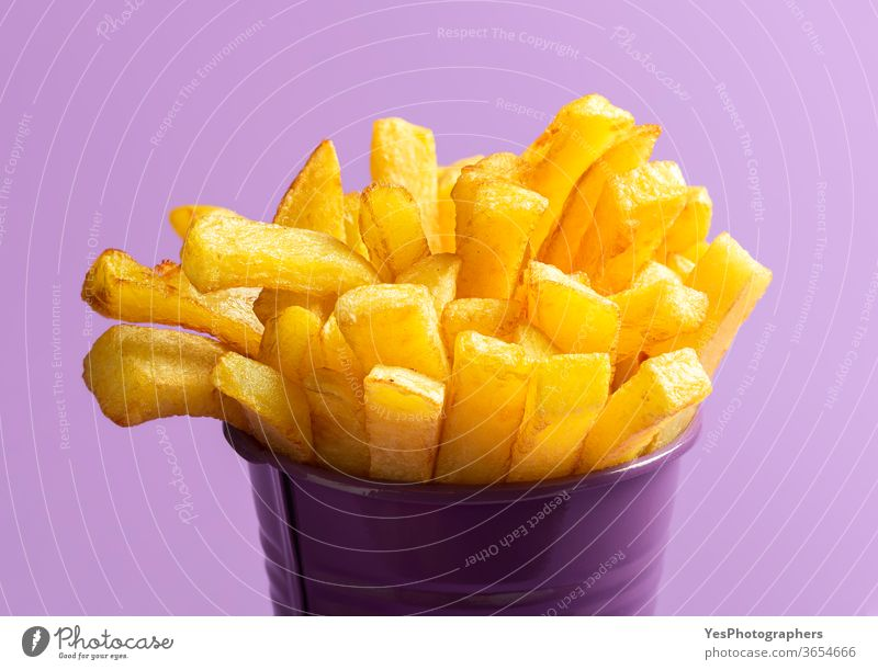 French fries close-up. Deep-fried food. French fries on purple background american calories chips cholesterol crispy cuisine deep-fried delicious dinner