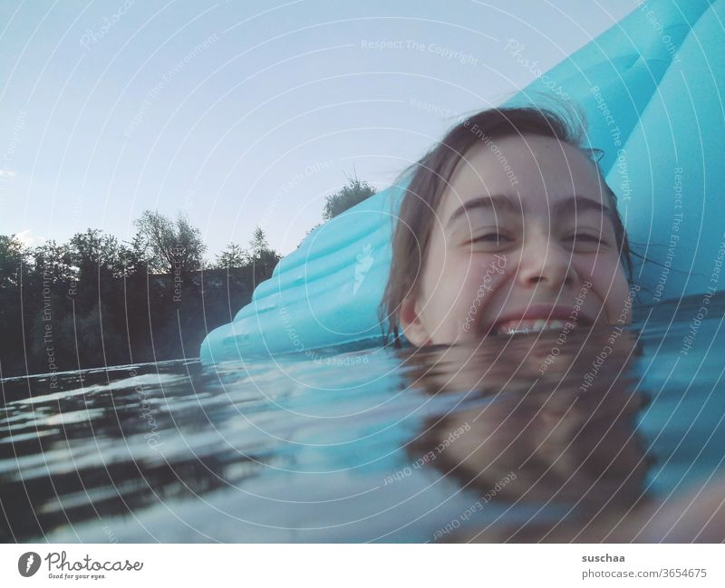 laughing teenagers in sea water with air mattress Summer Lake bathe stay at home holidays at home seaside resort be afloat Wet cooling girl Youth (Young adults)