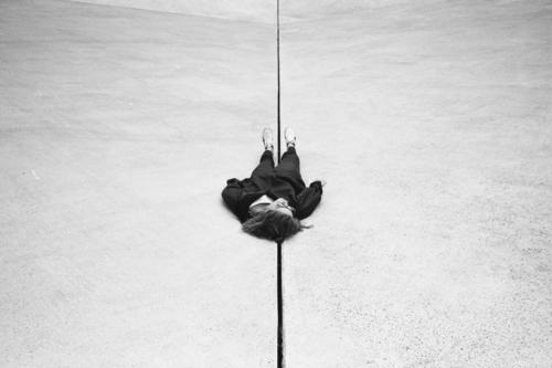 In the exact middle of nowhere Black & white photo Girl Woman lying on the ground Frustration Relaxation depression Lost dead having a rest Art relax relaxation