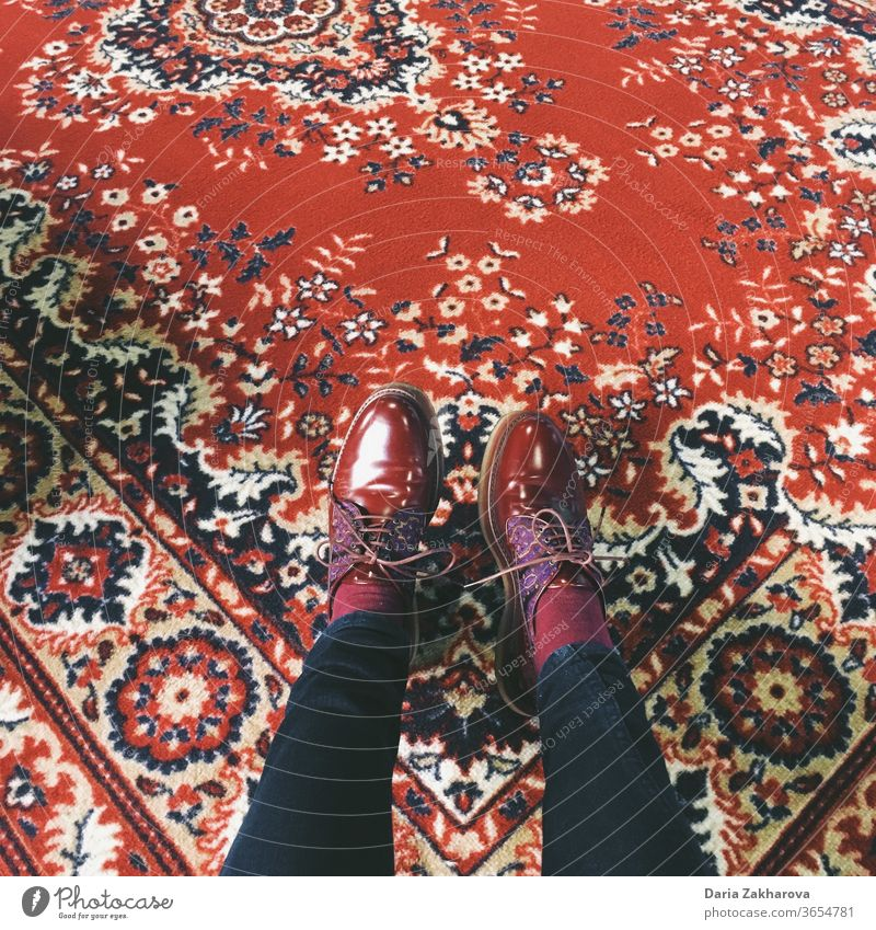 red shoes on red soviet carpet Perfect match Feet Carpet Legs Footwear Floor covering maroon Brown Pants Woman Clothing Feminine Jeans Colour photo Fashion Red