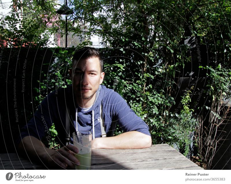 Portrait of a handsome young man with a shadow covering half his face adult attractive background casual covered eurasian eurasian man guy human male millennial