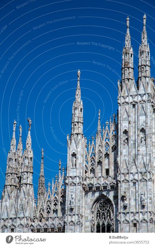 The facade of the Milan Cathedral in front of a blue sky. Italy Architecture Europe Town Exterior shot Tourism Vacation & Travel Historic Old town built
