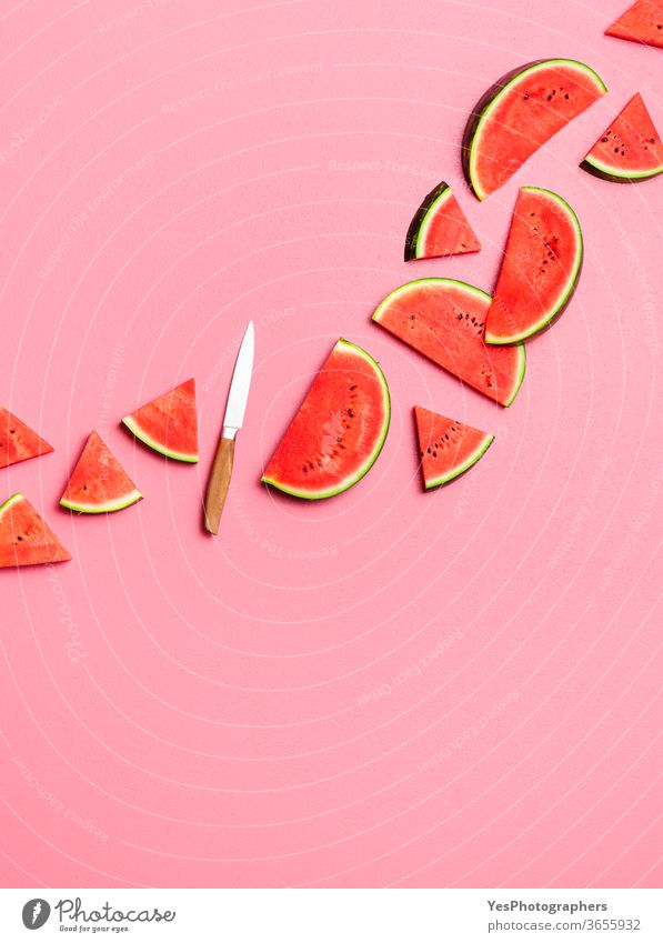 Watermelon slices flat lay on a pink background. Fresh summer fruits above view arranged cut out delicious dessert diet dieting food fresh green healthy eating