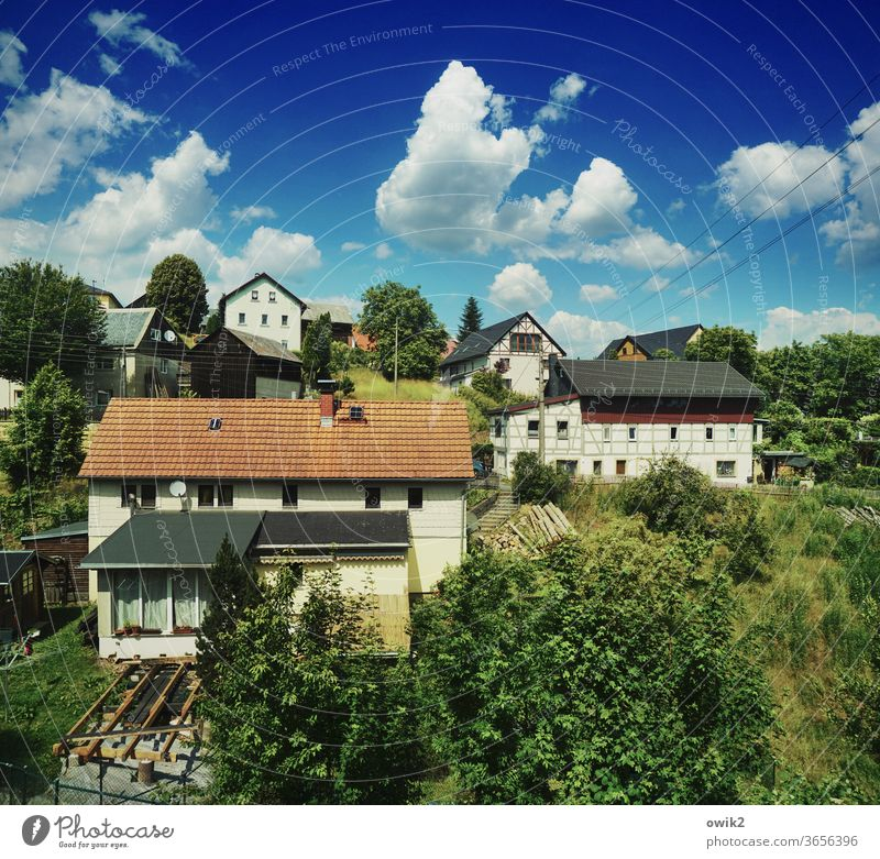 Village landscape houses Half-timbered facade Window roofs huts Idyll Sky Clouds natural close to nature Veranda Village idyll Exterior shot Colour photo