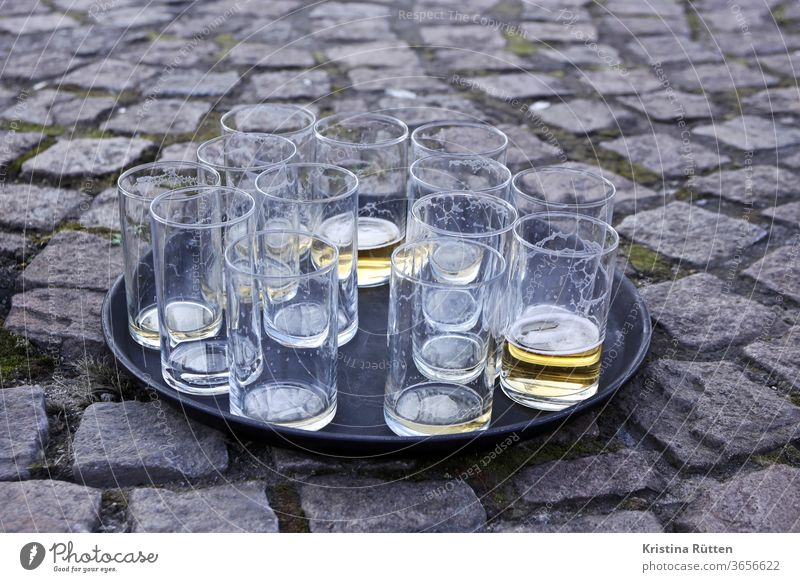 drunk beer glasses Beer glass Glazier Tray drinks Empty drunk up Pils Kölsch Old out Street Ground turned off Shooting match funfair Festival Street party