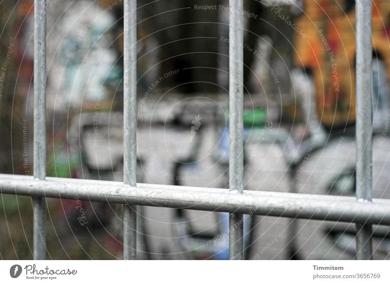 Grid in front of a Berlin graffiti Graffiti Metal Fence Colour Barrier Deserted Exterior shot Letters (alphabet) variegated