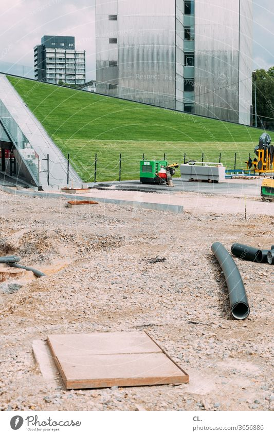 playground Construction site High-rise Architecture built Town Manmade structures Meadow Lawn urban Modern New Modern architecture Change Deserted Exterior shot