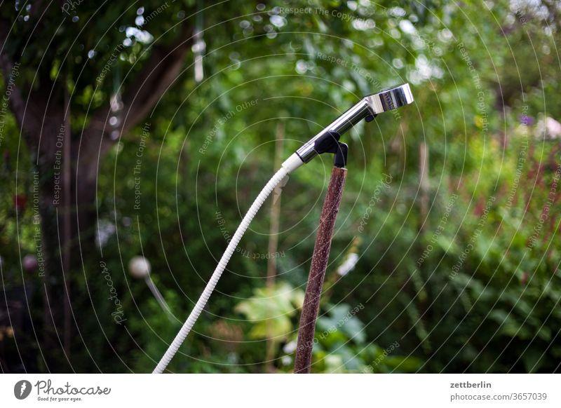 Shower in the garden Garden allotment hygiene neat Refreshment Water Hose Water hose Shower head Bracket microphone holder Microphone Branch tree bush green