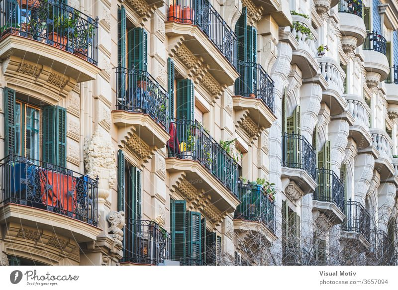 Low angle view of rows of neoclassical balconies on the facade of a residential building pot balcony plant exterior ornament construction old style railing