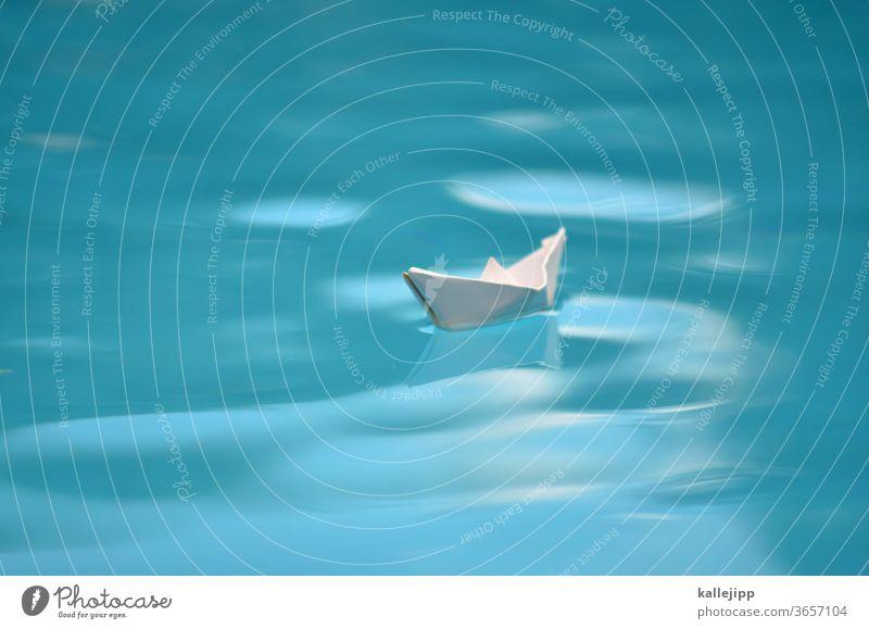 symbolbid paper ship in water Paper boat Water voyage Traveling Waves Small Orientation Navigation Sailing Sailing ship peril explorers Columbus ocean Blur