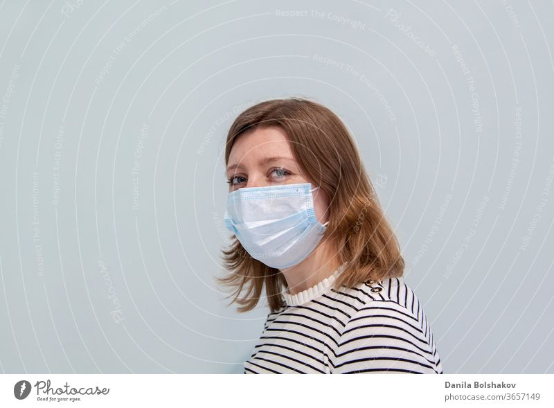 woman wearing an anti-virus protection mask to prevent flu infection, allergies, virus protection, COVID-19, and corona virus pandemic disease 2019 2019-ncov