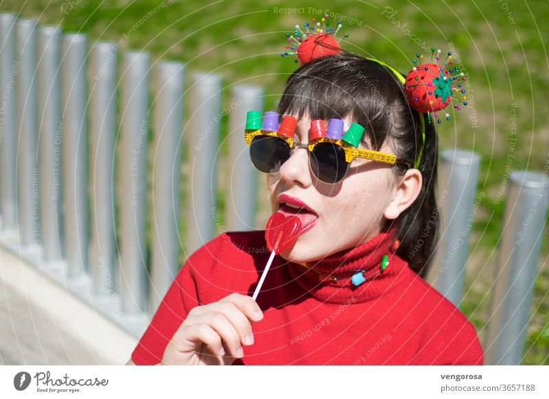 Pin-up teen with sewing accessories and eating a lollipop young girl Multicoloured Red teen girl teenage teenager Fringe pretty beauty portrait fringe hairstyle