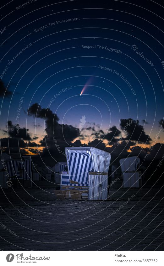 Comet Neowise over a beach chair at the North Sea coast stars Beach Saint Peter Ording sanct peter-ording St. Peter-Ording Night Astronomy Astrophotography
