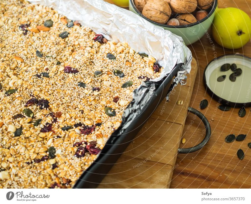 Home made healthy energy granola with nuts almond protein bar muesli peanut butter home made pumpkin baked fruit crunchy background food grain breakfast snack