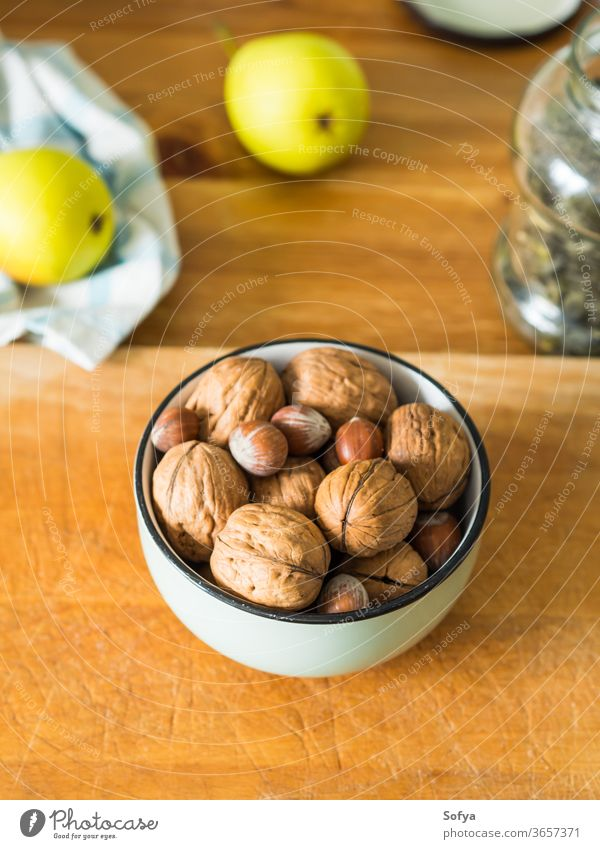 Walnuts and hazelnuts in bowl on wooden board. walnut vitamin kitchen energy protein food fruit nature tasty snack shell organic nutshell natural ingredient