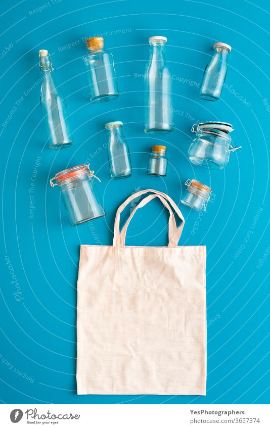 Plastic-free containers for groceries. Glass bottles and jars top view above view background bag blank blue bulk shopping buy clean concept conservation cotton