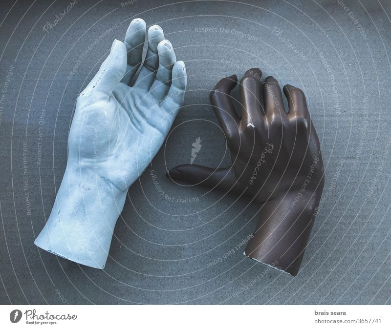 Black and white mannequin hands. manikin body couple interracial couple marriage relationship model sculpture skin problem skin care issues deteriorate rusty