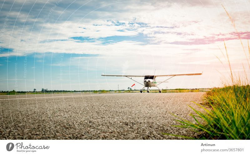 Small airplane coming  on a taxiway in the morning with beautiful blue sky. Bright life. High growth and high risk business concept. outdoor wings fly wheels