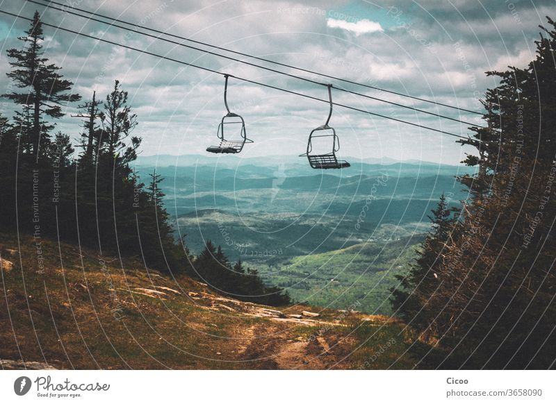 Empty chairlift in summer over green landscape chair lift elevator Ski piste Summer Dirty outlook farsighted farsightedness Landscape Nature Sky Exterior shot