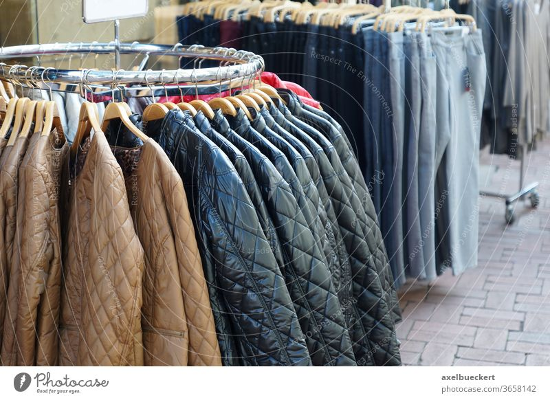 quilted jackets and jeans for sale fashion shopping winter coat clothing clothes boutique store casual display retail hanger rack wardrobe collection garment
