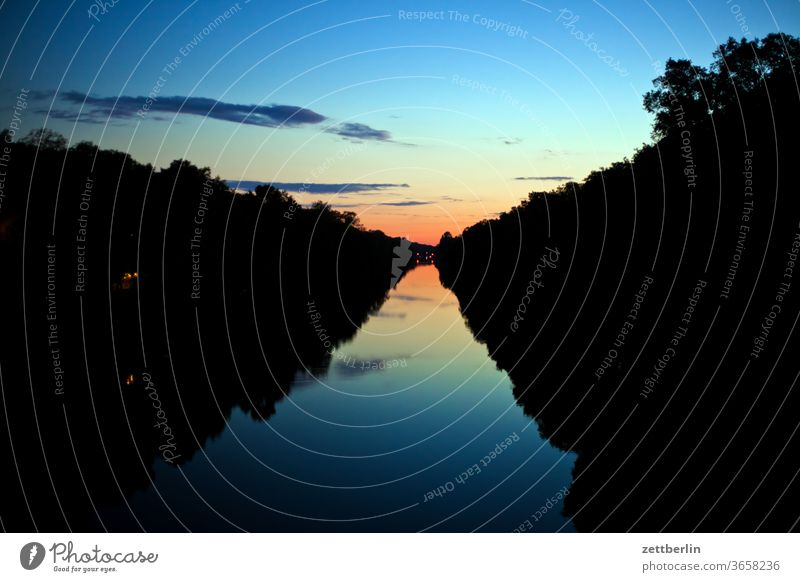 Hohenzollern canal in the evening Evening Channel Light Visual spectacle Night at night Nature shipping bank Transport Water sunset Sunset Spectrum
