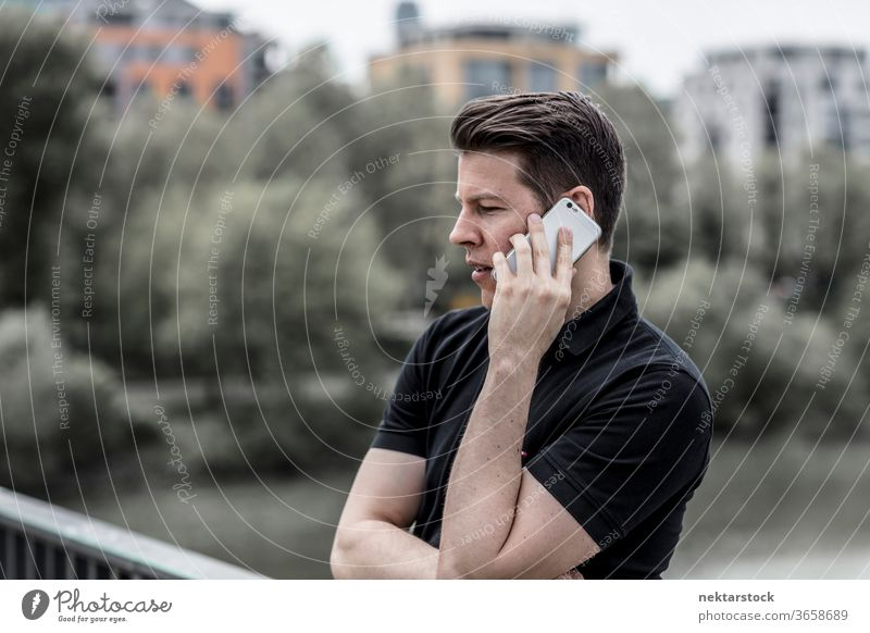 Profile of Man Talking on a Phone mobile phone talking man adult close up profile telecommunication technology electronic gadget conversation hand