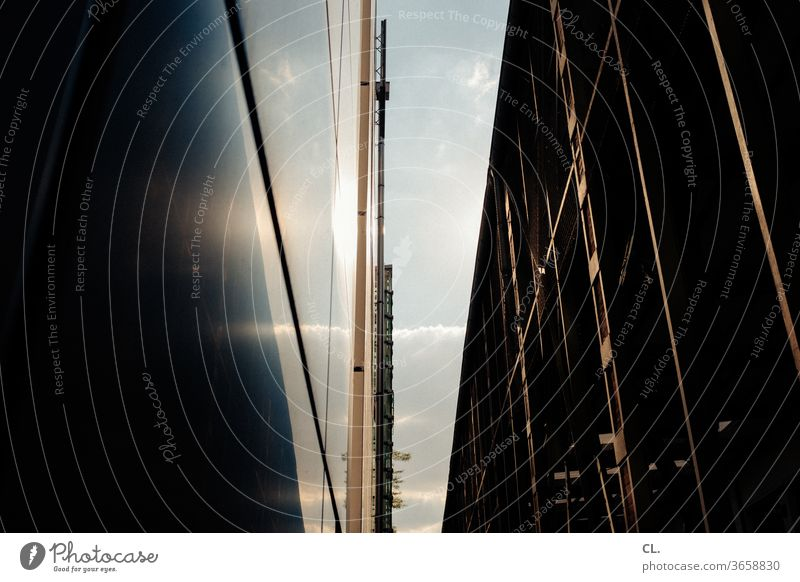 sky and buildings Architecture built Part of a building Facade Town Sky Wall (building) architectural photography Structures and shapes Vista Esthetic Abstract