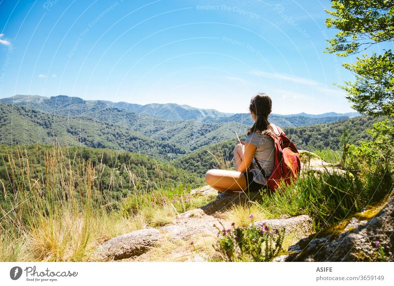 Hiker girl enjoying the nature in summer people mountain freedom hiking alone landscape Artikutza Basque Country trekking woman hiker travel journey