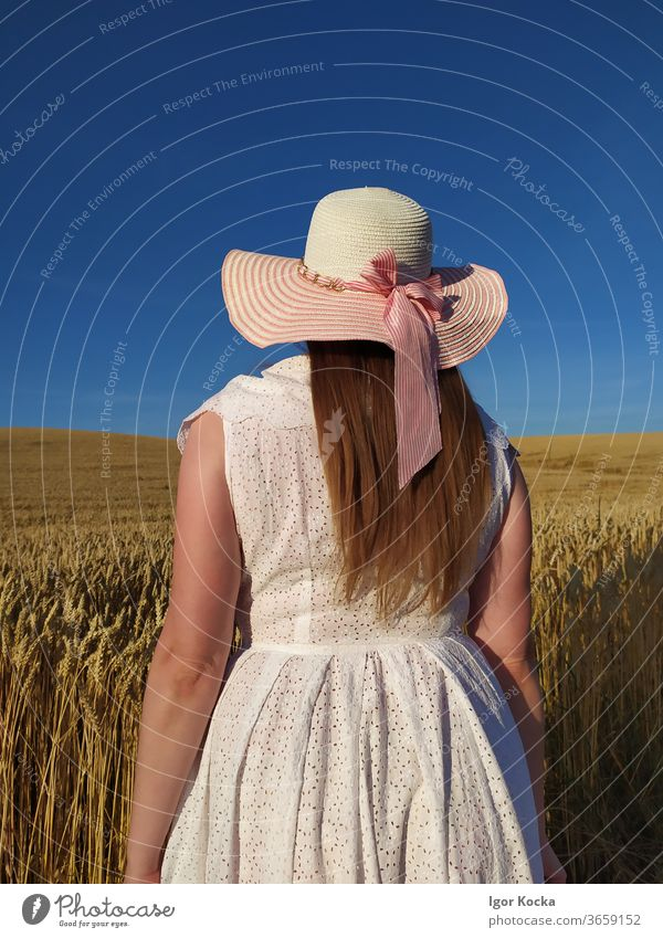 Rear View Of Woman In Field Against Sky woman Farm Hat Crops Blue Sunlight Rear view Portrait photograph Fashion white dress Rural Scene Agriculture