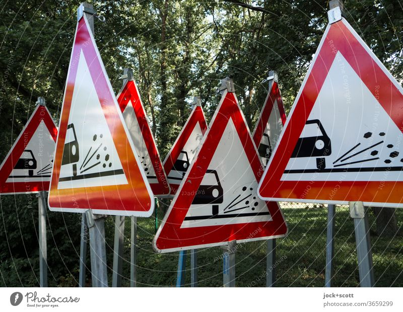 One cannot warn often enough against uncontrolled flying loose chippings Road sign StVO Triangle rolled gravel Many Warning sign Collection Red Preparation