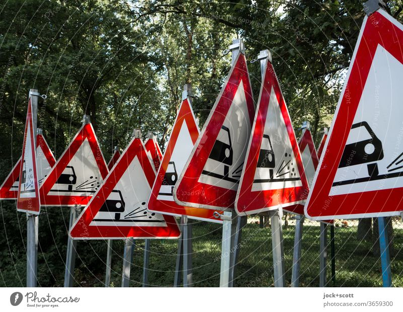 One cannot warn often enough of uncontrolled flying loose chippings Road sign Triangle StVO rolled gravel Signs and labeling Warning sign Red Many Collection
