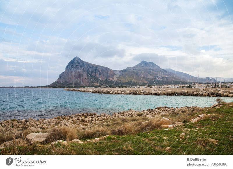 View to San Vito lo Capo in Sicily in the background the Monte Monaco with a height of 532m. Italy vacation Exterior shot Deserted Europe Colour photo Landscape