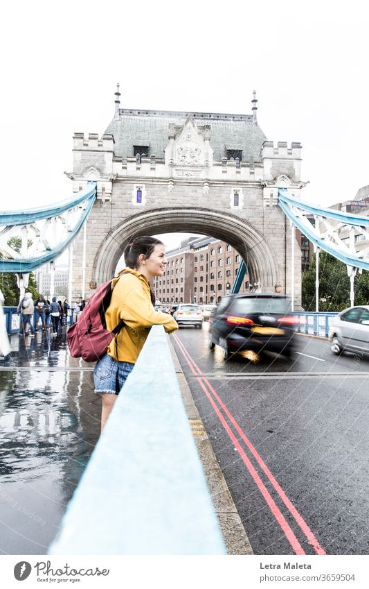 Girl in the London bridge in a rainy day girl young woman young girl teenager Smiley smile face happy girl yellow london bridge London Underground