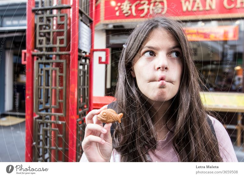 girl funny fish face in Chinatown funny face fish cookie sweet fish chinatown london red teenager fish lips Fish mouth Fish food City trip city scape urban girl