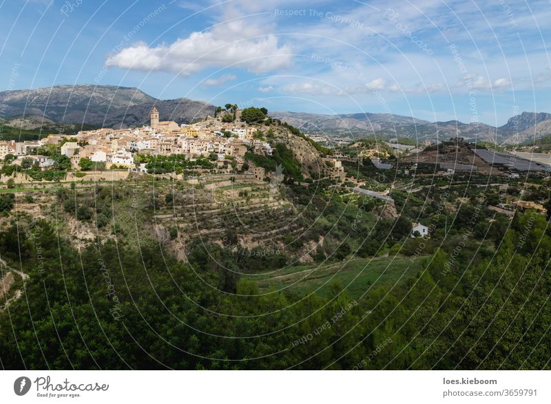 Panorama view of the hills of Polop de Marina with church and castell over green forest at the Costa Blanca, Spain polop spain mountain travel architecture