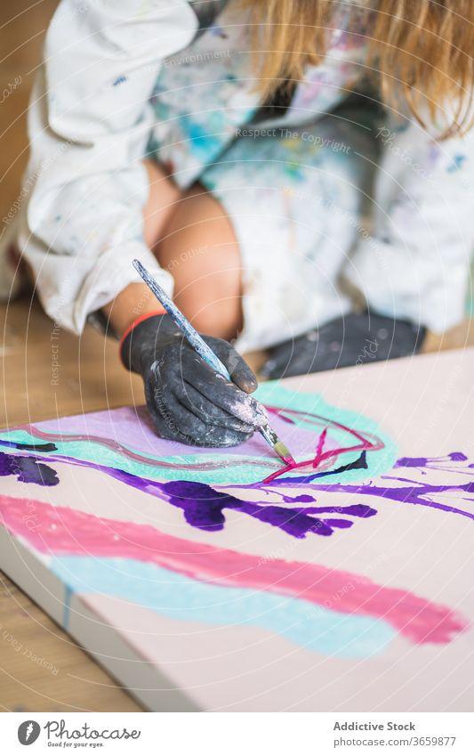 Crop unrecognizable artist with paintbrush mixing paints on palette talent craft process gouache workshop glove dirty plastic illustration studio robe woman