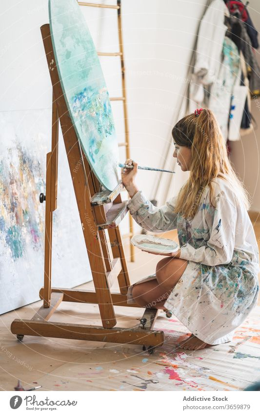 Female artist painting picture on easel canvas seascape woman creative talent young female paintbrush draw lifestyle hobby inspiration craft artwork painter