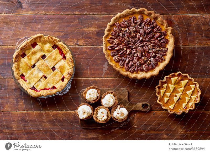 Variety of thanksgiving pies on wooden table. food pecan apple pumpkin variety season autumn baking dinner seasonal round traditional closeup fresh cuisine