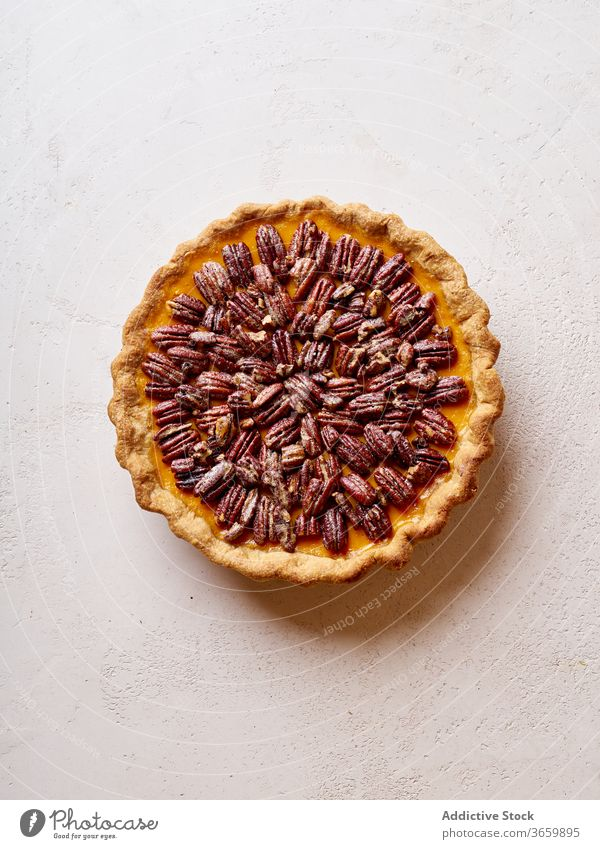 Overhead image of pecan pumpkin pie thanksgiving food variety season autumn baking dinner seasonal round traditional closeup fresh cuisine table festive