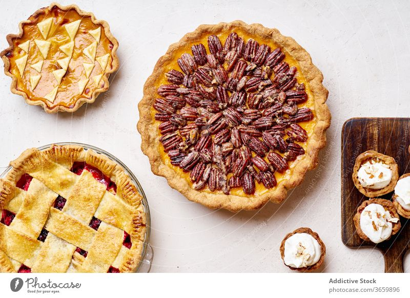 Top view of variety of thanksgiving pies food pecan apple pumpkin season autumn baking dinner seasonal round traditional closeup fresh cuisine table festive