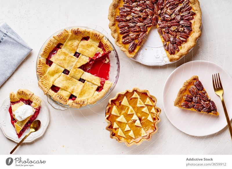 Top view shot of variety of thanksgiving pies food pecan apple pumpkin season autumn baking dinner seasonal round traditional closeup fresh cuisine table