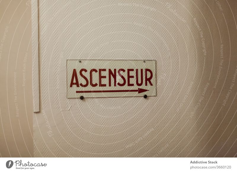 French signage ascenseur directing to elevator signboard french arrow right wall navigate waymark inscription indication signal symbol building guide glass