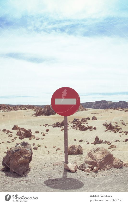 No entry road sign on dry desert road no entry prohibit one way rectangle regulation caution restriction stop signboard notice warning round red daytime terrain