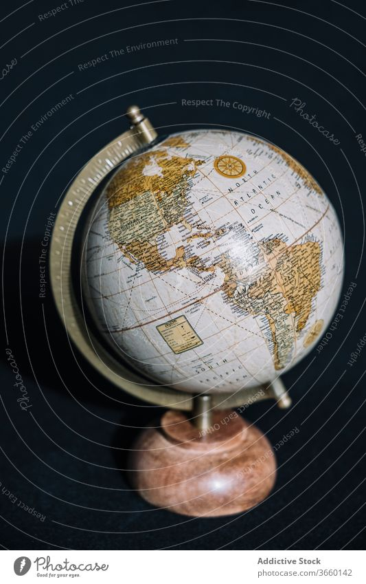 Desk globe of Earth on black background map cartography earth planet world display cozy geography america education travel information school contemporary